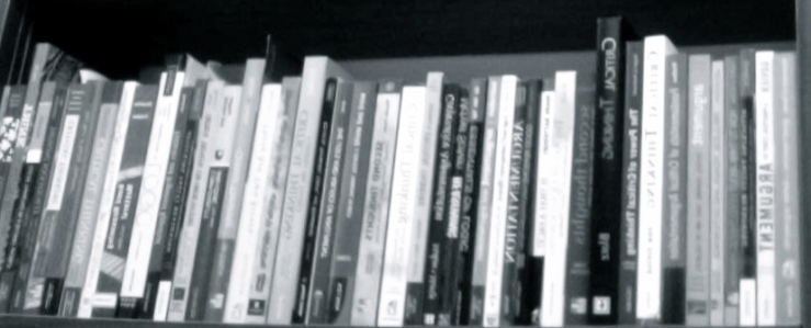black and white image of critical thinking textbooks packed tightly on a shelf